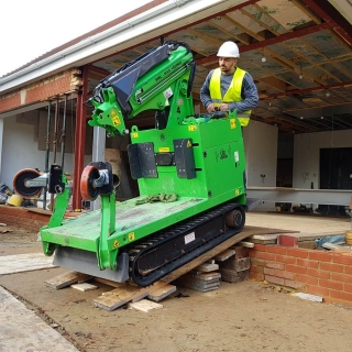The Hooka all terrain mini crane moving down ramp restricted access building site