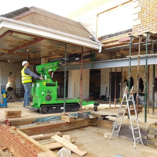 The Hooka lift and carry all terrain mini crane lifting 1300kg steel i-beam