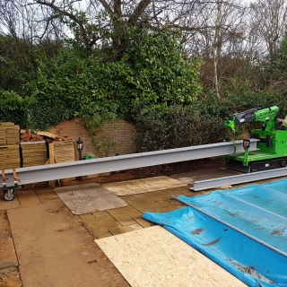 lift carry all terrain mini crane moving 1300kg steel i-beam through tight access
