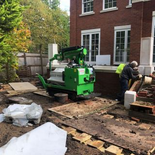 6-Hooka-tracked-crane-forklift-carrying-half-tonne-pillar-across-site-with-difficult-access-over-thick-mud-in-Ascot-Berkshire