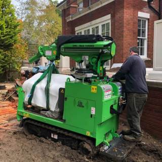 7-Hooka-tracked-crane-forklift-carrying-half-tonne-pillar-across-thick-mud-on-site-with-difficult-access-in-Ascot-Berkshire