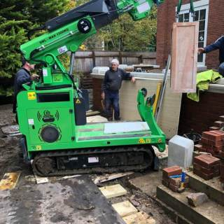 8-Hooka-tracked-crane-forklift-lifting-half-tonne-pillar-in-thick-mud-on-site-with-difficult-access-in-Ascot-Berkshire