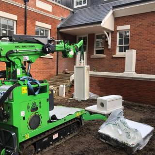 9-Hooka-tracked-crane-forklift-safely-lifting-half-tonne-pillar-in-thick-mud-on-site-with-difficult-access-in-Ascot-Berkshire