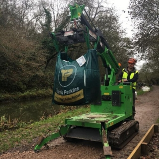 The Hooka on hire delivering Travis Perkins bulk bags on restricted towpath better alterntative to tracked dumper and digger