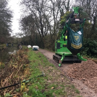 The Hooka on hire emptying bulk bags on restricted towpath better alterntative to a telehandler and all terrain forklift