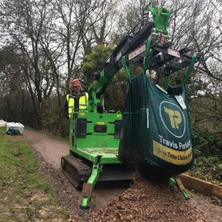 The Hooka on hire emptying bulk bags on restricted towpath better alterntative to a tracked dumper and digger