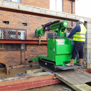 The Hooka maneuvering 450kg I-beam up ramp preparing for lift - Image 3