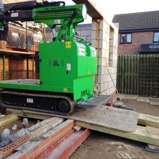 The Hooka maneuvering 450kg I-beam up ramp preparing for lift - Image 4