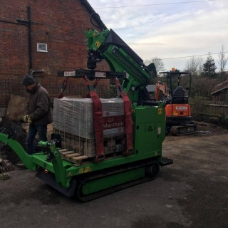 Hooka all terrain tracked dumper better alternative mini crane on hire in West Sussex to easily lift and move heavy pallet of Marshalls paving block