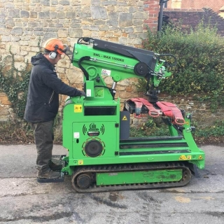 Hooka all terrain tracked forklift on hire to safely lift and move heavy pallet of Marshalls paving slabs