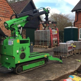 Hooka all terrain tracked mini crane on hire to safely lift and move heavy pallet of Marshalls paving blocks