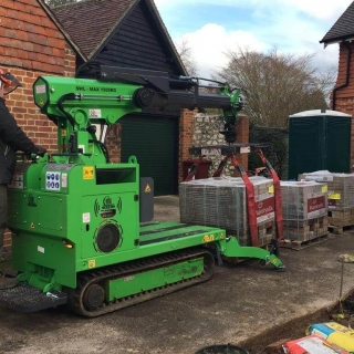 Hooka mini forklift crane on hire in Midhurst West Sussex to easily lift and move heavy pallet of Marshalls block paving