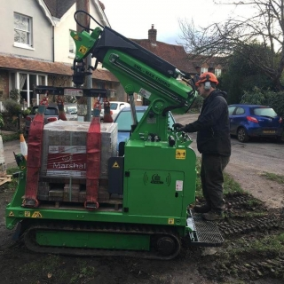 Hooka mini forklift crane on hire in Midhurst West Sussex to safely and easily lift and move heavy pallet of Marshalls block paving