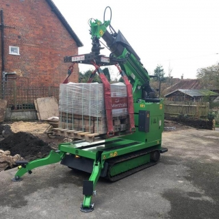 Hooka mini forklift truck crane on hire in Midhurst West Sussex to easily lift and move heavy pallet of Marshalls block paving