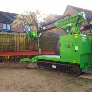 450kg steel beam moving and installation with the Hooka mini tracked crawler crane lift and carry crawler, alternative to manual handling. Hired from Hook-up Solutions call 01462 499 642