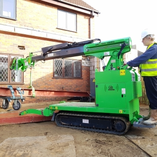 Moving 450kg steel beam for installation with the Hooka mini tracked crawler crane, precision lift image 2. Hired from Hook-up Solutions call 01462 499 642