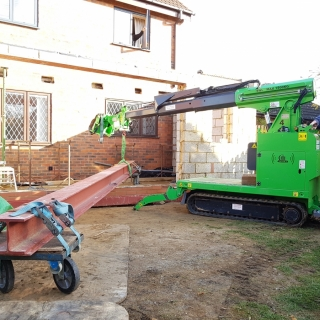 Moving 450kg steel beam for installation with the Hooka mini tracked crawler crane, precision lift. Hired from Hook-up Solutions call 01462 499 642