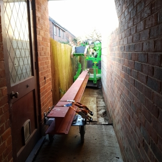The Hooka mini tracked crawler crane accessing a very narrow alley the hooka can move heavy steel beams saving on crane hire. Hired from Hook-up Solutions call 01462 499 642