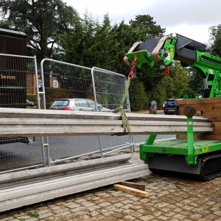 The Hooka mini tracked crawler crane being hired in Hampshire to move block and beam flooring instead of a mini crane. Hired from Hook-up Solutions call 01462 499 642