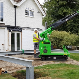 The Hooka mini tracked crawler crane carefully and easily placing a vertical steel beam into position on a site with tight side access. Hired from Hook-up Solutions call 01462 499 642