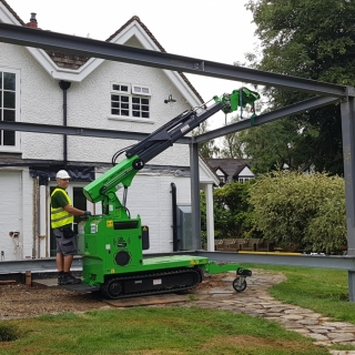 The Hooka mini tracked crawler crane installing steel beam with ease. Hired from Hook-up Solutions call 01462 499 642