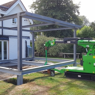 The Hooka mini tracked crawler crane installing steel beams for a large conservatory using a steel beam lifter. Hired from Hook-up Solutions call 01462 499 642