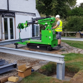 The Hooka mini tracked crawler crane lifting and moving a steel beam with precision. Hired from Hook-up Solutions call 01462 499 642
