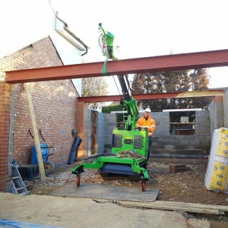 The Hooka mini tracked crawler crane on hire lifting a RSJ Beam into position. Hired from Hook-up Solutions call 01462 499 642