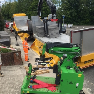 The Hooka  mini tracked crawler crane on hire ready to move bulk materials from roadside to point of use on tight access building site T