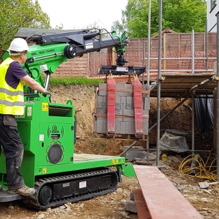 Mini tracked crawler crane Hire the Hooka, the better alternative to all terrain forklift or telehandler for moving pallets of blocks safely and easily on building site with restricted access