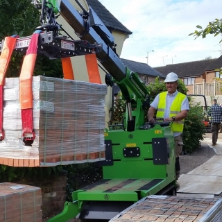 The Hooka mini tracked crawler crane on hire as a better alternative to all terrain forklift or telehandler for moving pallets of bricks safely and easily on building site with restricted access