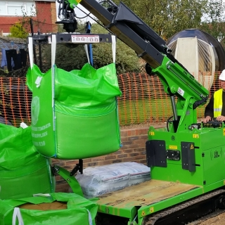 The Hooka, mini tracked crawler crane, hired as the better alternative to tracked forklift or dumper for moving bulk bags safely and easily on building site with restricted access