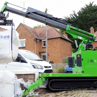 Hire the Hooka mini tracked crawler crane, better safer alternative to a wheelbarrow for manual handling of bulk materials on building site with restricted access