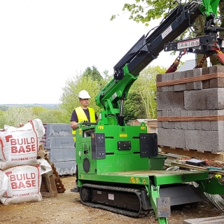 Hire the Hooka mini tracked crawler crane as the better safer alternative to manual handling for moving pallets of blocks safely and easily on building site with restricted access