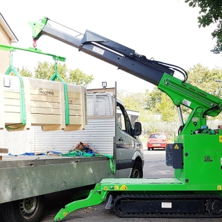 Hire the Hooka mini tracked crawler crane for lifting and moving heavy crates of materials from roadside to point of use