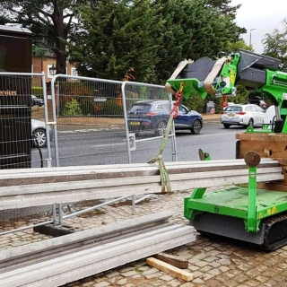 The mini tracked crawler crane Hooka on hire for  lifting, transport install block and beam flooring from roadside to point of use on site with restricted access alternative to a crane