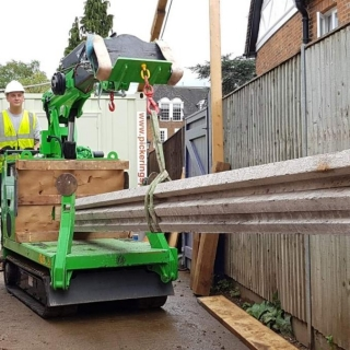 Mini tracked crawler crane Hire the Hooka to lift, transport install block and beam flooring from roadside to point of use on site with restricted access alternative to a telehandler