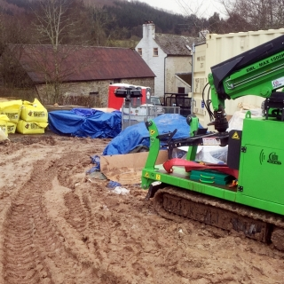 The Hooka on site hire with DIY SOS the only machine that could cope with such muddy conditions to move bulk bags and other building materials from roadside