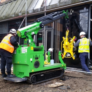 How to install heavy glass panels on a site with narrow access with the Hooka mini tracked crawler crane on hire