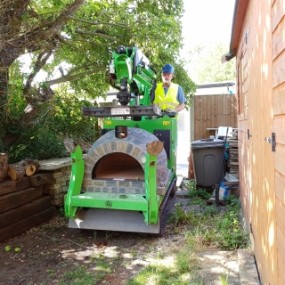 Installing a pizza oven with the Hooka mini tracked crawler crane makes lifting a pizza oven easy