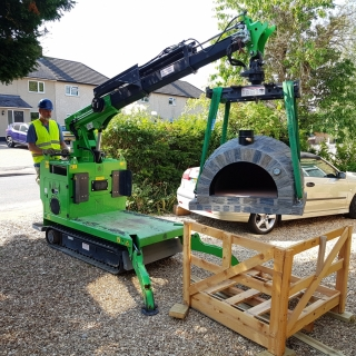 Lifting a Pizza Oven into position with the hooka mini tracked crawler crane