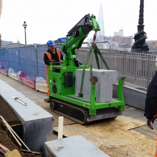 The Hooka mini tracked crawler crane makes easy work of lifting and carrying large concrete blocks into place on sites with tight access