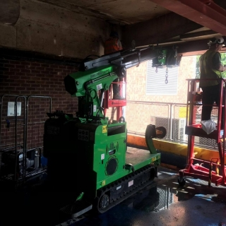 Hooka-installing-steel-beams-in-Gloucester-lift-and-carry-crawler-crane-tracked-forklift