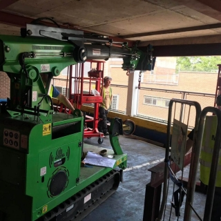 Hooka-lifting-11-steel-beams-in-Gloucester-lift-and-carry-crawler-crane-tracked-forklift