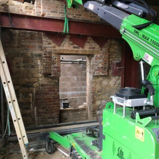 Taking-Down-Steel-Beams-from-a-Temporary-Installation1