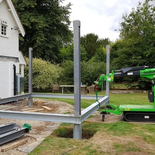 The Hooka lifting and moving a steel beam with precision on site with restricted access