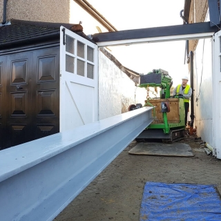 how to safely move a steel I-beam for a picture frame with the hooka steel beam lifter