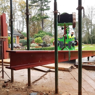 The Hooka easily and safely threading 350kg steel I-beam through acroprops prior to lifting into place