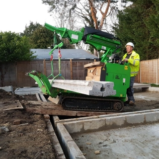 11 - The Hooka tracked forklift mini crane lifts and carries heavy concrete beams in to place safely