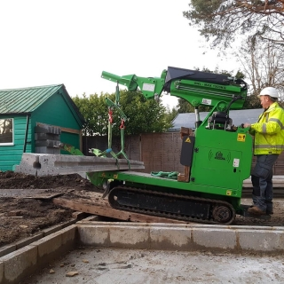 12 - The Hooka tracked forklift mini crane lifts and carries heavy concrete beams in to place safely